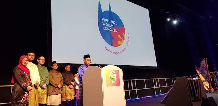Taqrir Akramin Khalib, President of Hemophilia Society of Malaysia delivering his speech during the destination handover ceremony at the WFH Congress 2018 held in Glasgow, Scotland